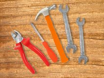 Hammer, screwdriver and wrenches over wooden Royalty Free Stock Images