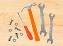 Hammer, screwdriver and wrenches on wooden table. Background Royalty Free Stock Images