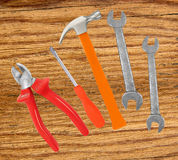 Hammer, screwdriver and wrenches on wooden table. Background Royalty Free Stock Image