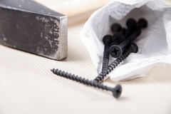 Hammer and screws Royalty Free Stock Photos