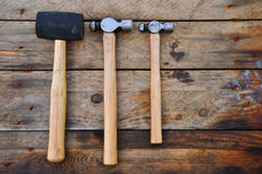 Hammer set of hand tools or basic tools on wooden background Royalty Free Stock Images