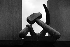 Hammer & Sickle. This statue of hammer and sickle is a part of Soviet WWII monument in Terezin, Czech Republic Stock Photo