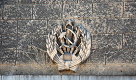 Hammer and sickle. Bas-relief of the Soviet era in St. Petersburg, Russia stock photos
