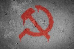 Hammer and sickle,Communism symbol. Spray painted on the wall, socialism, sign, communist, retro, vintage, icon, soviet, ussr, emblem, grunge, background, old stock photo
