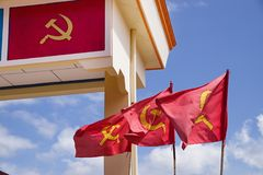 Hammer And Sickle Flags And Decoration. Yellow and read hammer and sickle flags and decoration on an arch in Laos these are the flag of the Lao People`s stock photos