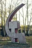 Hammer and sickle. Monument hammer and sickle is on the grass stock photography