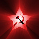 Soviet star symbol red light flare. A five point star, inside hammer and sickle sign with powerful red light halo. Extended flares for cropping Royalty Free Stock Image