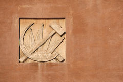 Hammer and Sickle. Stucco decoration in Yekaterinburg, Russia. Royalty Free Stock Photo
