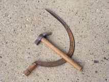 Hammer and sickle symbol of communism. Over concrete stock images