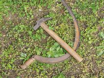 Hammer and sickle symbol of communism. Over the grass stock images