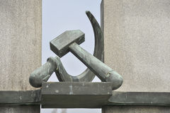 Hammer & sickle. This statue of hammer and sickle is a part of the Soviet WWII monument at the cemetery in Terezin, Czech Republic stock images