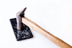 Hammer and  smartphone with broken screen on white. Stock Image