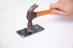 Hammer and smartphone with smashed display Royalty Free Stock Images