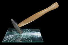 Hammer smashed a mirror. On a black background Royalty Free Stock Images