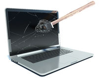 Hammer smashes laptop on a white background Stock Photos