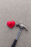 Hammer smashes red heart Stock Images