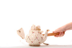 Hammer smashing antique pot Royalty Free Stock Photo