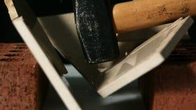 Hammer smashing a tile over bricks stock video
