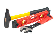 Hammer, spirit level, a wrench Royalty Free Stock Image