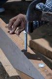 Hammer. Striking a nail.Construction Man Using royalty free stock images