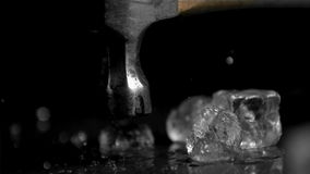 Hammer in super slow motion breaking ice cubes stock video