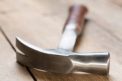Hammer on table Stock Photography