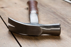 Hammer on table Royalty Free Stock Images