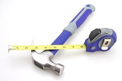 Hammer Tape Measure. Hammer and Tape Measure focus Tape Measure stock images