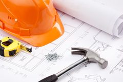 Hammer, tape measure, hard hat and nails Stock Photos