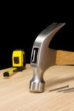 Hammer, tape measure and nail Stock Images