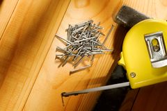 Hammer, tape measure and nails Stock Image