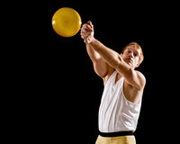 Hammer Throw. Athlete. Studio shot over black royalty free stock image
