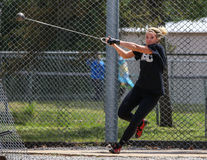 Hammer Throw. A female athlete swings and makes her first hammer throw attempt during a track meet in Redding, California on May 26, 2014 royalty free stock photos