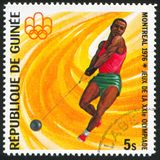 Hammer throw. GUINEA CIRCA 1976: stamp printed by Guinea, shows Hammer throw, circa 1976 royalty free stock images