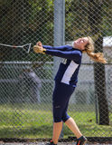 Hammer Throw Release. A female athlete swings and makes her first hammer throw attempt during a track meet in Redding, California on May 26, 2014 stock image