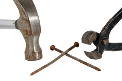 Hammer, tongs and two nails Stock Photos