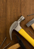 Hammer tool and nail on wood Stock Photography