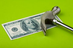 Hammer on top of dollar note Stock Images