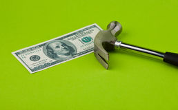 Hammer on top of dollar note. To illustrate currency crisis in Europe Stock Images