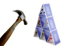 Hammer and tower of cards. Business concept isolated on white background stock image