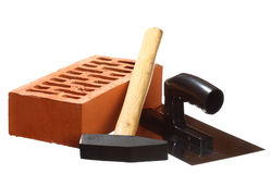 Hammer, trowel and a brick Royalty Free Stock Image