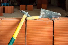 Hammer and trowel on construction site Stock Images