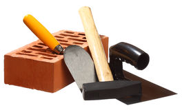 Hammer, trowels and a brick Royalty Free Stock Photography