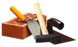 Hammer, Trowels und ein Ziegelstein Lizenzfreie Stockfotografie