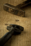 Hammer and used adjustable wrench Stock Photography