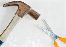 Hammer win scissor as rock paper scissors game Royalty Free Stock Photography