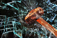 Hammer Through Window. Royalty Free Stock Photography