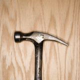Hammer on wood. Royalty Free Stock Images