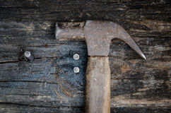 Hammer on wood Stock Image