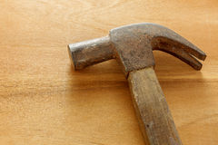 Hammer on wood background. Stock Images